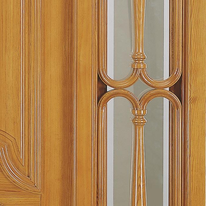 Detalle del torneado en los barrotes de puerta
