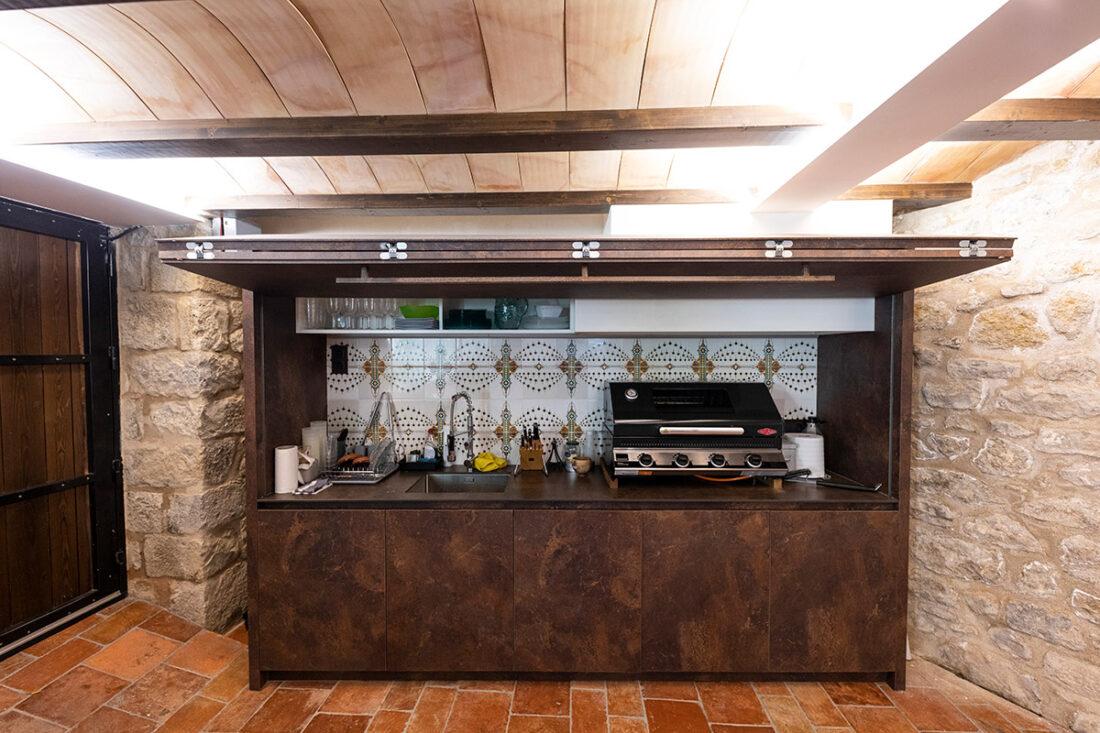 Cocina plegable en terraza interior